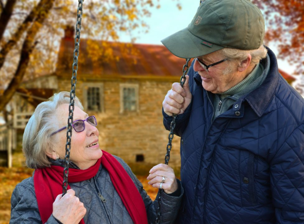A couple talking about the independent pension advice they just received.