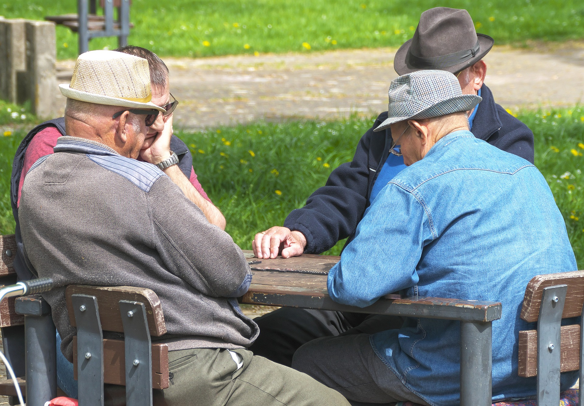 Friends gathering round to share independent pension advice with each other.